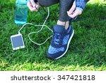 sports woman legs in sneakers... | Shutterstock . vector #347421818