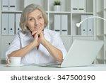 happy elderly woman working on... | Shutterstock . vector #347500190