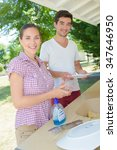 young couple washing dishes on... | Shutterstock . vector #347646950