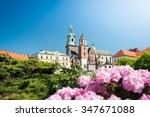 Stock photo beautiful old wawel cathedral in krakow poland green trees and rose flowers surround medieval 347671088