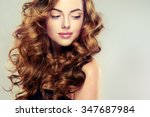Stock photo beautiful girl with long wavy hair brunette with curly hairstyle 347687984