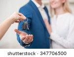 close up of hand of realtor... | Shutterstock . vector #347706500