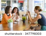 waitress takes pictures for two ... | Shutterstock . vector #347798303