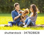 Stock photo lifestyle happy family of two resting at a picnic in the park with a dog 347828828