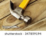 hammer and nails on wood  | Shutterstock . vector #347859194
