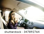 woman in car indoor keeps wheel ... | Shutterstock . vector #347892764