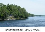 Moon River with cottages - stock photo