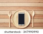 Top View Smartphone On Wooden...