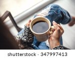 Girl\'s Hands Holding A Cup Of...