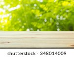close up top wooden table with... | Shutterstock . vector #348014009
