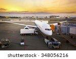 loading cargo on the plane in... | Shutterstock . vector #348056216