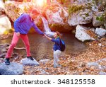 two hikers young man and... | Shutterstock . vector #348125558