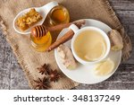 a white cup of green natural... | Shutterstock . vector #348137249