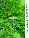 a simple wooden trail sign for...