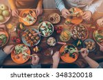 enjoying dinner with friends.... | Shutterstock . vector #348320018