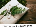 wrapped gift with fur tree...   Shutterstock . vector #348321578