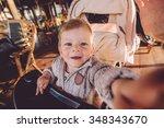 cute baby in stroller   Shutterstock . vector #348343670