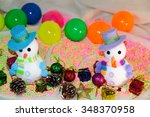 snowmen with hats and scarfs on ... | Shutterstock . vector #348370958