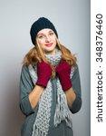 nice blonde girl in winter... | Shutterstock . vector #348376460