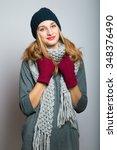 nice blonde girl in winter... | Shutterstock . vector #348376490