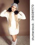 fashion studio photo of... | Shutterstock . vector #348389570
