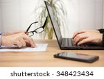 two partners are examining and... | Shutterstock . vector #348423434