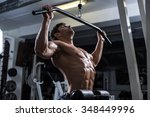 handsome bodybuilder works out... | Shutterstock . vector #348449996
