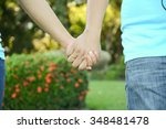 two pairs of hands in love... | Shutterstock . vector #348481478