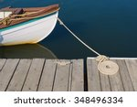 Wood Skiff Tied At Dock With...