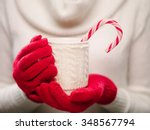 woman holds a winter cup close... | Shutterstock . vector #348567794