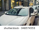 row of white taxi in milan | Shutterstock . vector #348574553
