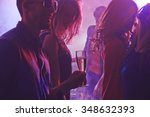 cheerful friends enjoying party ...   Shutterstock . vector #348632393
