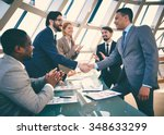 business partners handshaking... | Shutterstock . vector #348633299