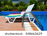 sun chairs at the pool | Shutterstock . vector #348663629