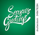 seasons greetings hand... | Shutterstock .eps vector #348678284