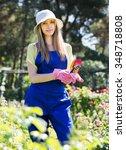 Smiling  Gardener In Uniform...
