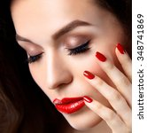red sexy lips and nails closeup.... | Shutterstock . vector #348741869