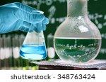 flask in scientist hand with... | Shutterstock . vector #348763424