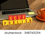 Small photo of Self Publish written on a wooden cube in a office desk