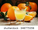 orange juice in a glass with... | Shutterstock . vector #348775358