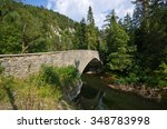 Old Stone Bridge Over The...