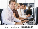 stock traders working at... | Shutterstock . vector #34878439