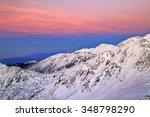 pink sky above snow covered... | Shutterstock . vector #348798290