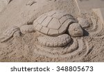 Sand Sculpture Of A Mother Sea...