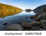 Stock photo mountain lake in early autumn sunlight 348847868