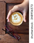 a cup of latte art coffee. | Shutterstock . vector #348956573