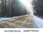 Winter Road Through The Woods