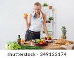 woman preparing dinner in a...   Shutterstock . vector #349133174