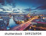 Stock photo aerial view of berlin skyline with dramatic clouds in twilight during blue hour at dusk with retro 349156934