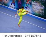 Small photo of JAKARTA, INDONESIA, NOVEMBER 14, 2015: Jesse Adalia from Singapore performs the movements in the men's Jianshu (sword) event at the 13th World Wushu Championship 2015 held in Istora Senayan, Jakarta.